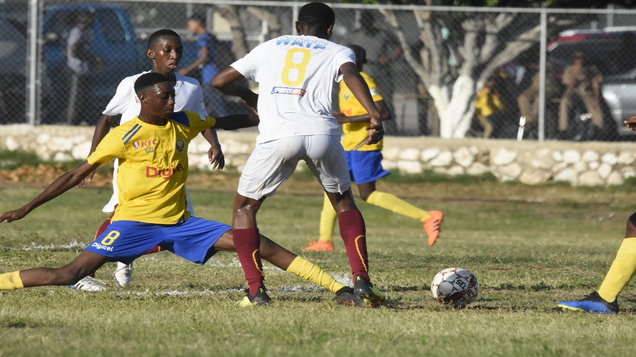 Deshawn Bernard (right) of Wolmer's Boys moves away from Waterford High's Akeem Chaplin during their ISSA/Digicel Manning Cup football match at Heroes Circle on Tuesday, September 11, 2018. (PHOTOS: Marlon Reid).