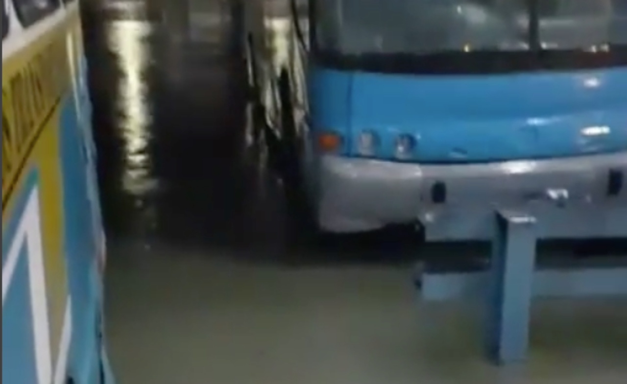 Bus parked in flood waters at Princess Alice Bus Terminal in Bridgetown last night. (Screenshot from video submitted to Loop's IG)