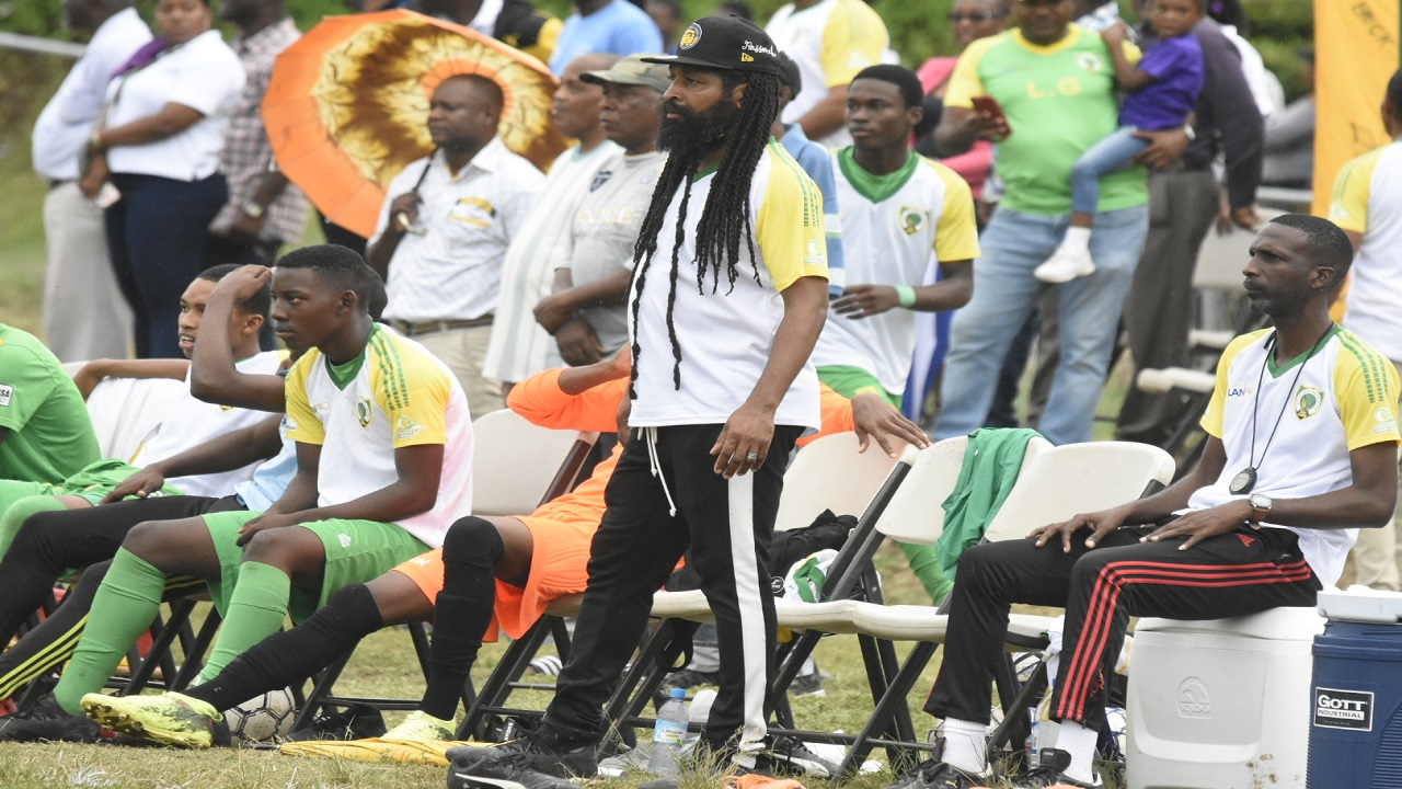 Excelsior High School head coach Daniel Riley watches his team tackle St Catherine High on Friday. Excelsior won the match 2 - 1.