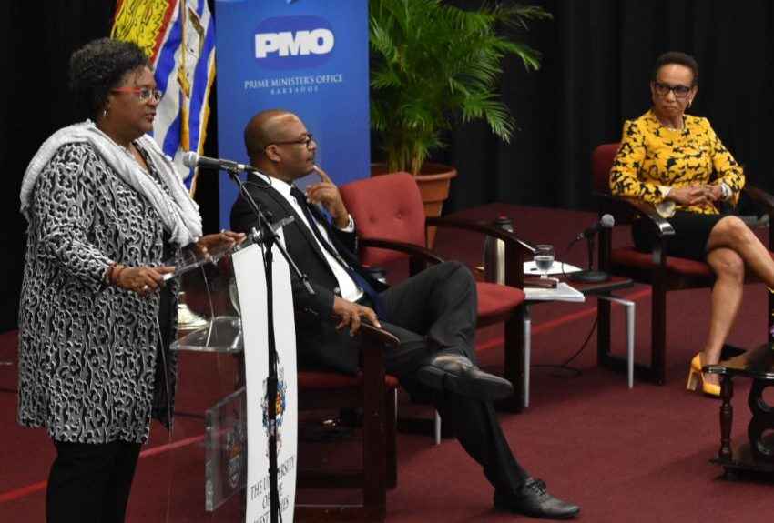 Prime Minister Mia Amor Mottley at the University of the West Indies Cave Hill Campus.  Listening attentively are Communications Officer, Cheston Lovell and Pro Vice-Chancellor and Principal of UWI, Cave Hill, Professor V Eudine Barriteau. (C.Pitt/BGIS)