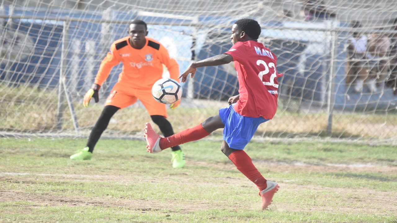 File photo of a Camperdown player controlling the ball during the school's Group C ISSA/Digicel Manning Cup football match at Norman Manley High last Friday.