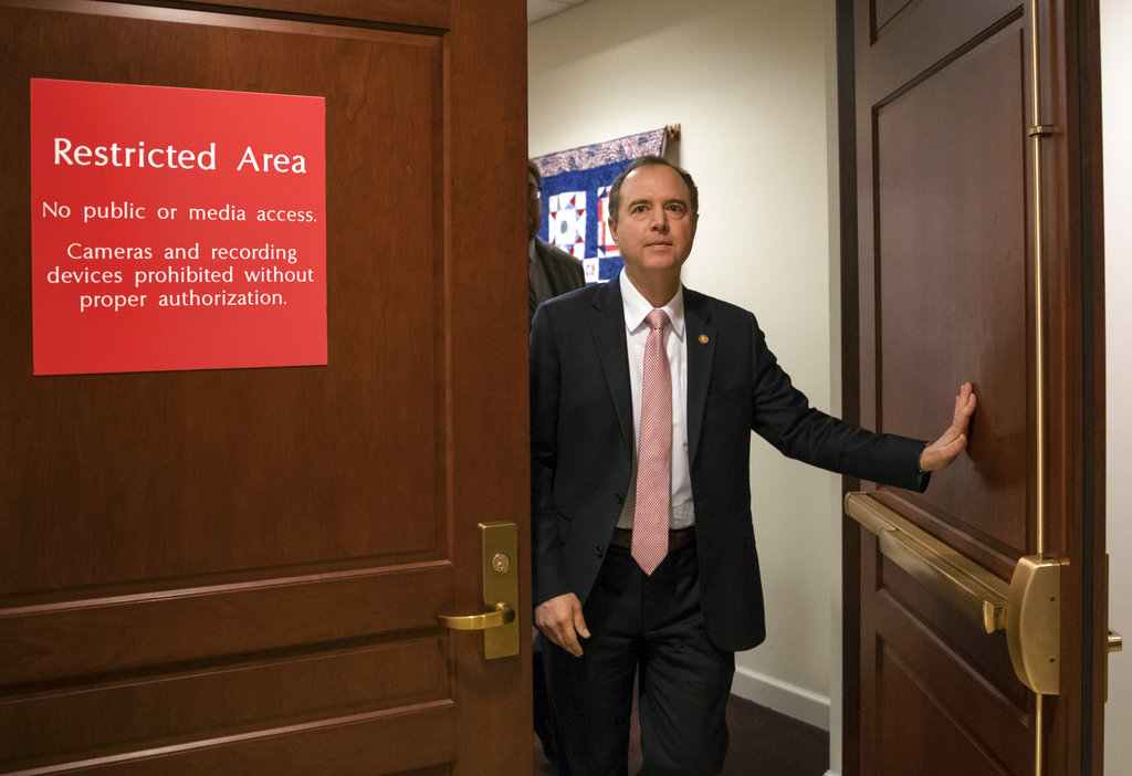 Rep. Adam Schiff, D-Calif., ranking member of the House Intelligence Committee, exits a secure area to speak to reporters, on Capitol Hill in Washington. (AP Photo/J. Scott Applewhite)