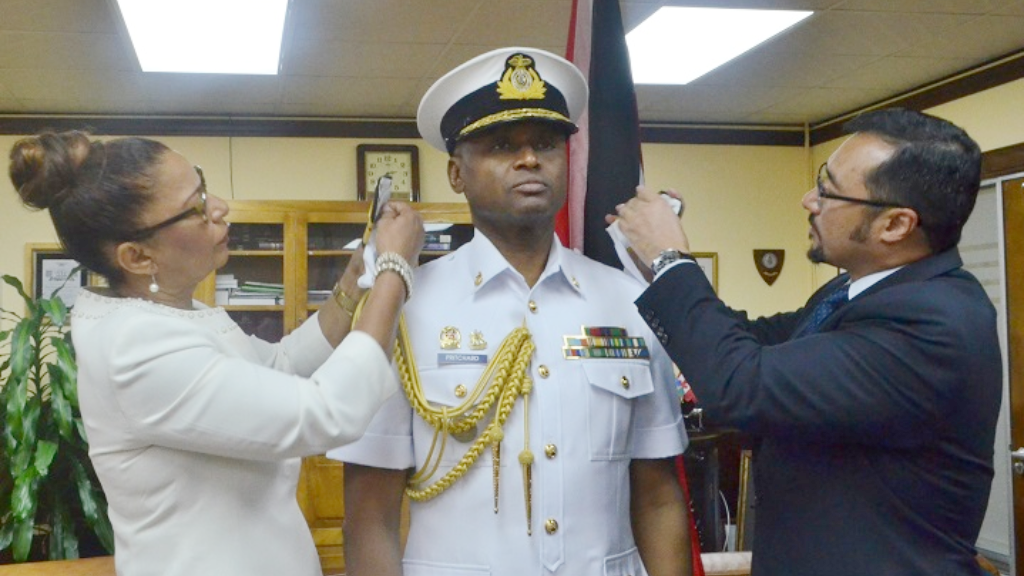 Rear Admiral Hayden Pritchard being decorated by National Security