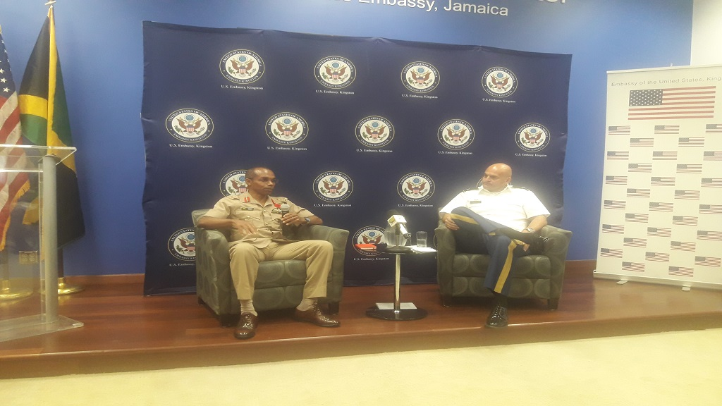 Lieutenant Colonel Pablo Raggio (right), senior defence official/defence attache for the US Embassy in Kingston, and Chief of Defence Staff for the Jamaica Defence Force (JDF), Major General Rocky Meade, discuss a point during a press conference at the US Embassy in Kingston on Friday.