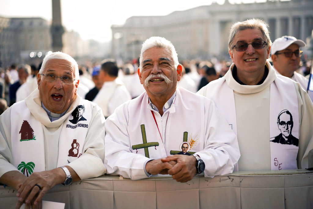 Priests wearing vestments with the effigy of martyred Salvadoran Archbishop Oscar Romero attend a canonization ceremony in St. Peter's Square at the Vatican. (AP Photo/Andrew Medichini)