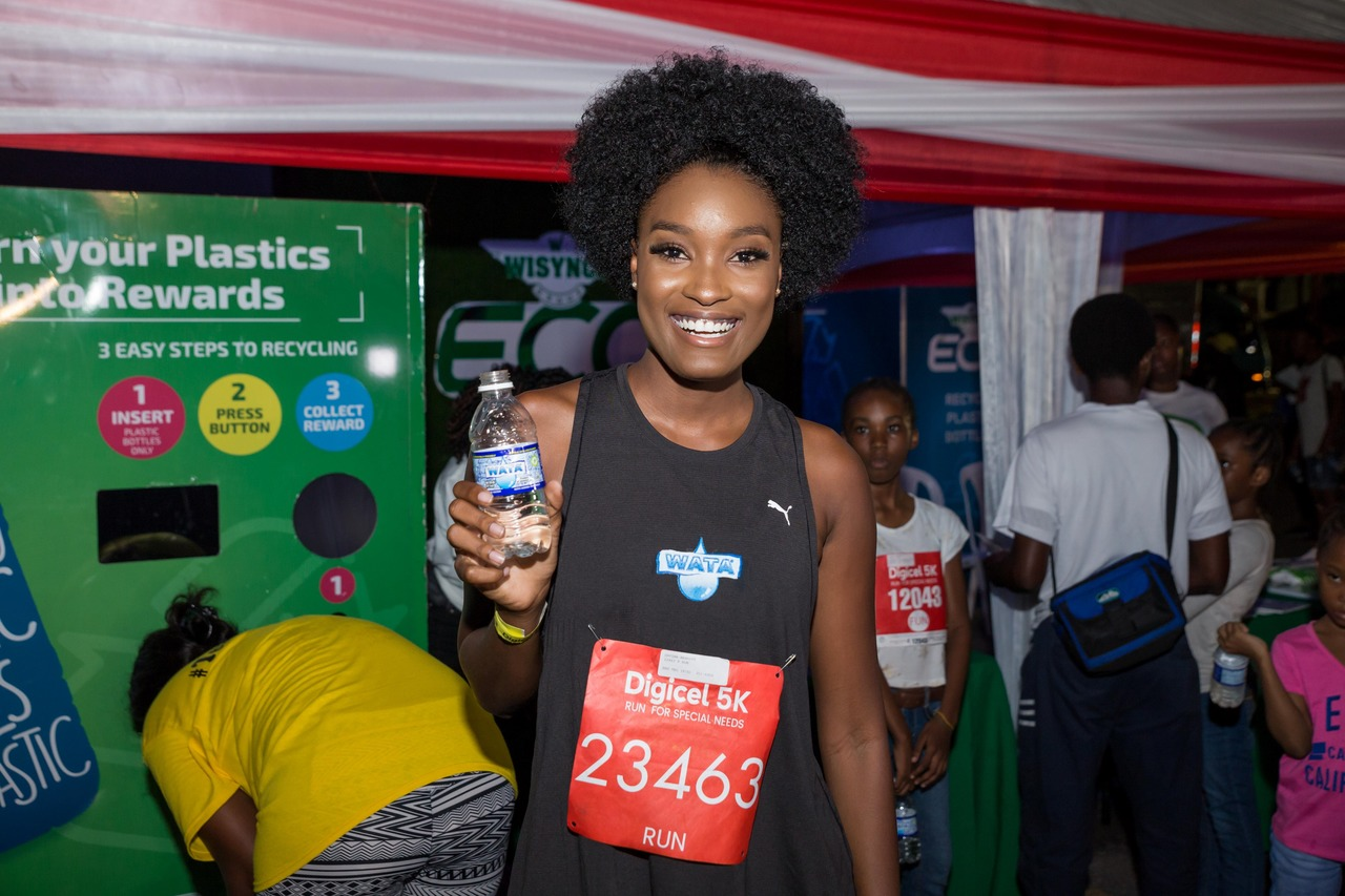 Davina Bennett - Wisynco's Lifestyle Ambassador staying hydrated with WATA at the Digicel 5K .