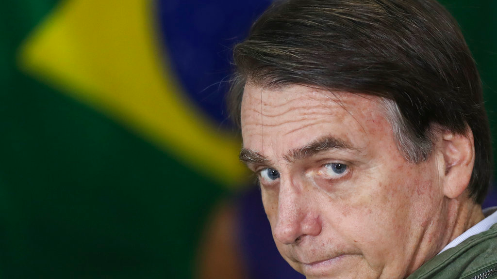 Jair Bolsonaro, presidential candidate with the Social Liberal Party, looks on as he arrives to cast his vote in the presidential runoff election in Rio de Janeiro, Brazil, Sunday, Oct. 28, 2018. (Ricardo Moraes/Pool Photo via AP)