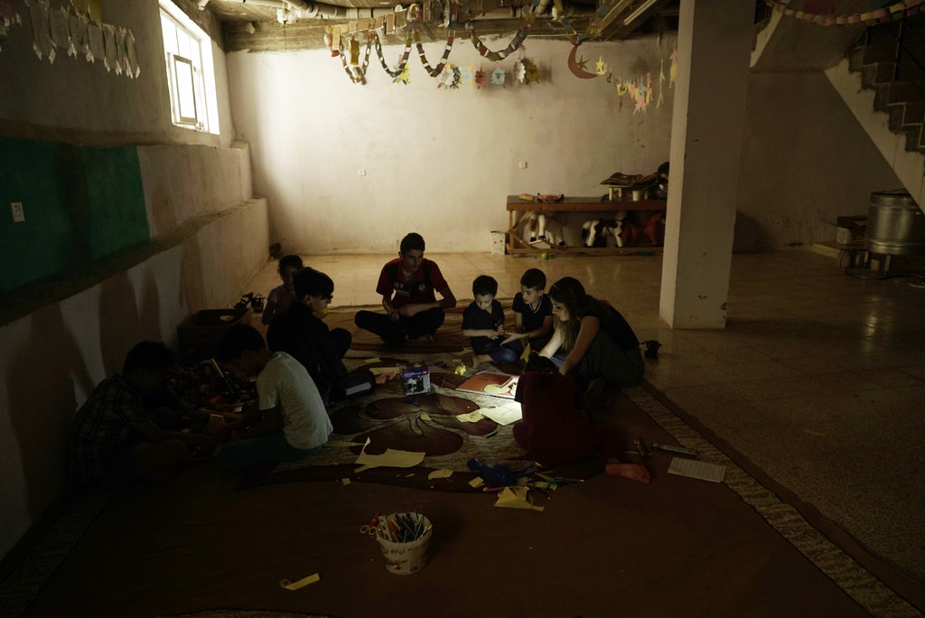 Yazidi children work on arts and crafts in the basement of an orphanage in Sheikhan, Iraq. (AP Photo/Maya Alleruzzo)