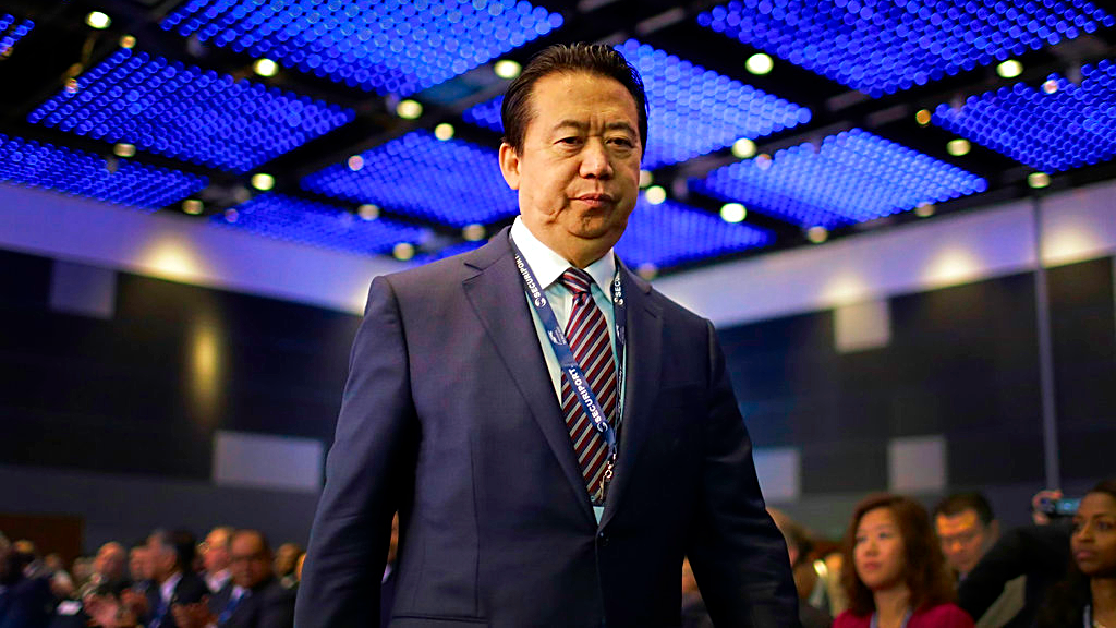 In this July 4, 2017 file photo, Interpol President, Meng Hongwei, walks toward the stage to deliver his opening address at the Interpol World congress in Singapore. A French judicial official says Friday Oct.5, 2018 the president of Interpol has been reported missing after traveling to China. (AP Photo/Wong Maye-E, File)