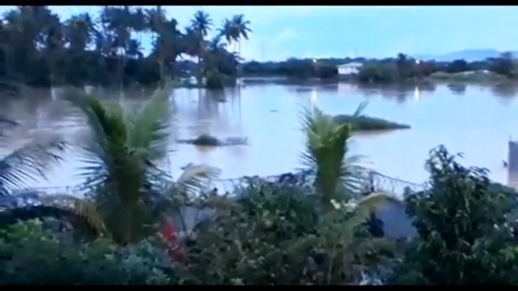 Photo taken from video footage in St Helena on October 20, 2018. Flooding almost covered homes in the area, trapping residents who stayed in the upper levels of neighbours' homes.