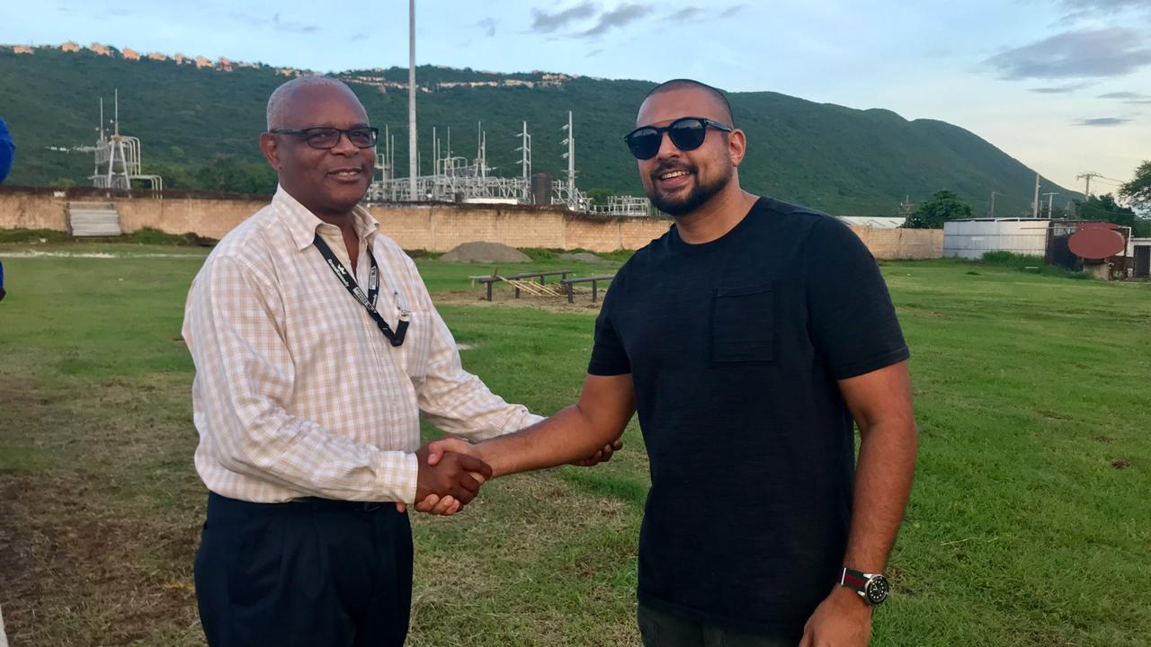 Dancehall star Sean Paul (right) with Major Desmon Brown, general manager of Independence Park Limited, which manages the National Stadium, after a meeting earlier this week.