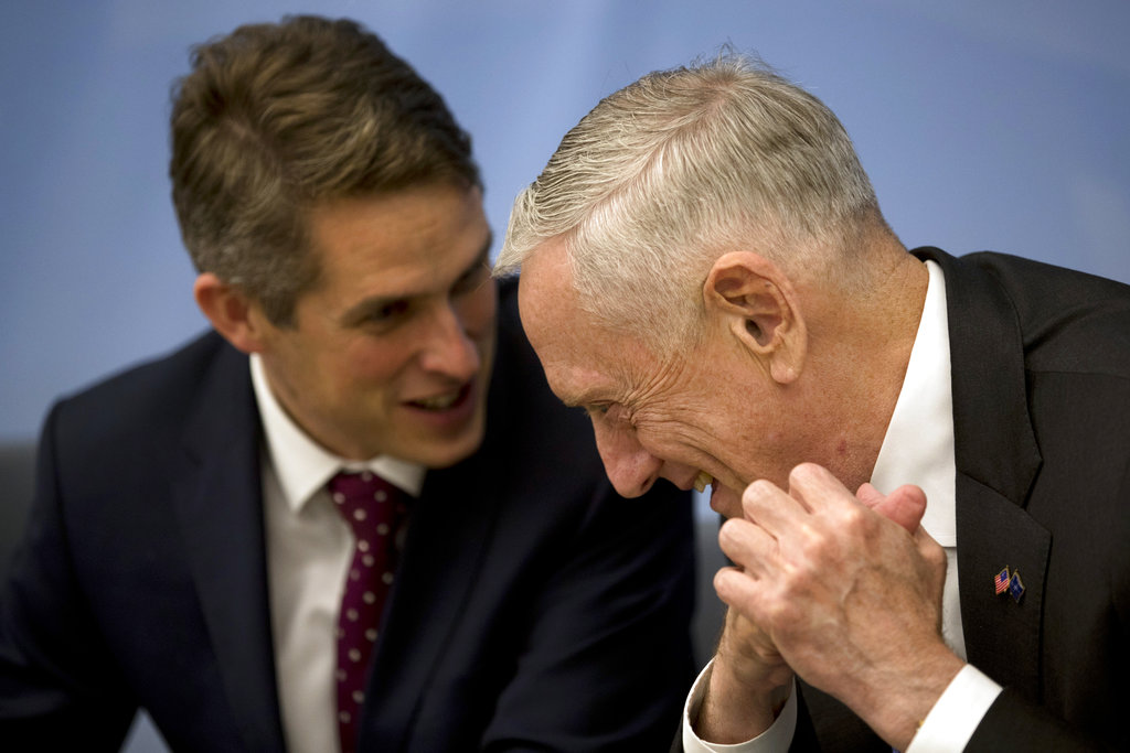 U.S. Secretary for Defence Jim Mattis, right, talks to Britain's Defence Minister Gavin Williamson before a signing ceremony following a meeting of NATO defence ministers at NATO headquarters in Brussels. (AP Photo/Francisco Seco, Pool)