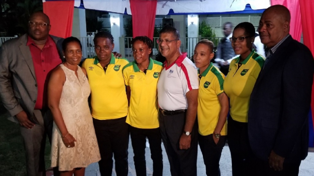 JFF President Michael Ricketts (right) poses with members of the Reggae Girlz squad and British High Commissioner Asif Ahmad (centre), team manager Jean Nelson (2nd left) and assistant coach Andrew Price (left) at the send-off reception held at the British High Commission in Kingston on Monday, October, 22, 2018.