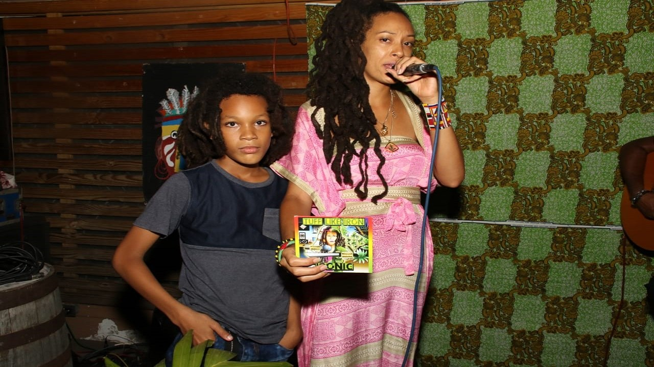 Tuff Like Iron on stage with her son Itongo during the launch of her debut album, 'Ironic', at the Stone's Throw lounge in St Andrew. (PHOTOS: Llewellyn Wynter)