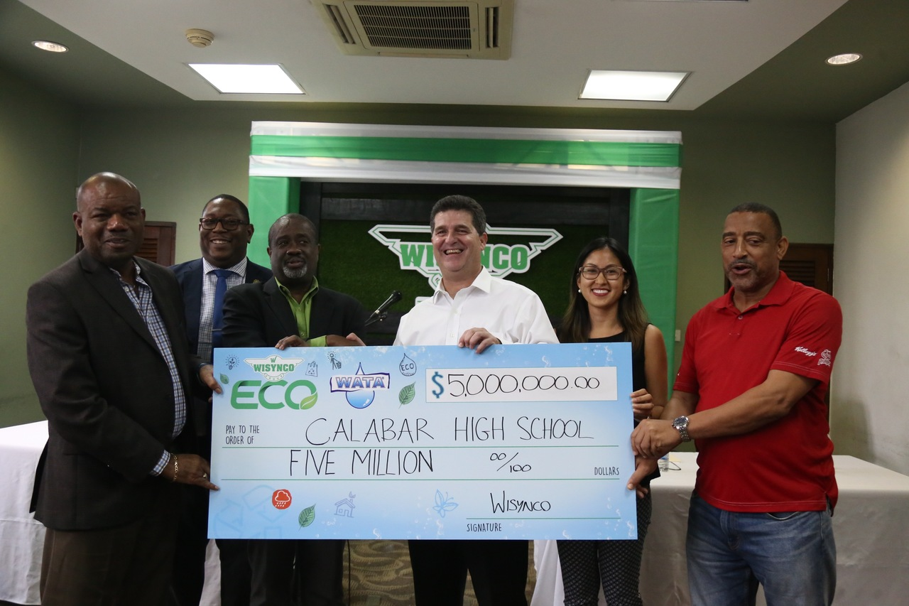 Chairman of Wisynco William Mahfood (third from right) presents a symbolic cheque for $5M for the renovation of a gymnasium at Calabar High School on Friday, September 28 at the Jamaica Baptist Union, founders of the educational institution, in Kingston. On hand for the occasion were (l-r) Calabar's Principal Albert Corcho; Acting Principal Calvin Rowe; Board Chairman Rev Karl Johnson; Wisynco's Food Service Divisional Manager Melissa Chuck and Director of Sales Hal Holness.