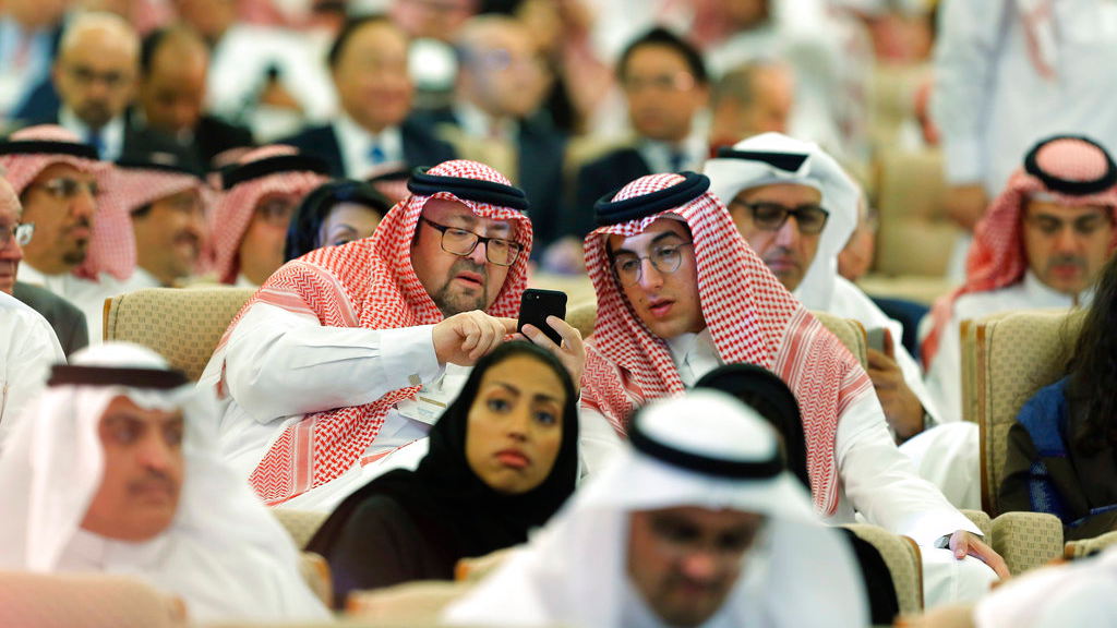 Participants attend the opening of the Future Investment Initiative conference, in Riyadh, Saudi Arabia. (AP Photo/Amr Nabil)