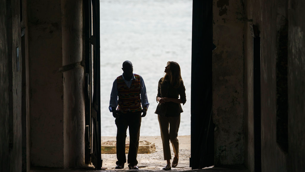 "First lady Melania Trump looks up as she walks through the ""Door Of No Return"" with Cape Coast Castle museum educator Kwesi Essel-Blankson as she visits Cape Coast Castle in Cape Coast, Ghana, Wednesday, Oct. 3, 2018. (AP Photo/Carolyn Kaster)"
