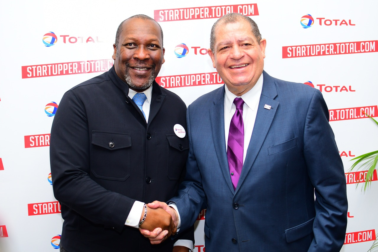 Total Jamaica Managing Director Chris Okonmah  (left) and Industry Minister Audley Shaw at the launch of the  Startupper of Year by Total Challenge in Kingston.