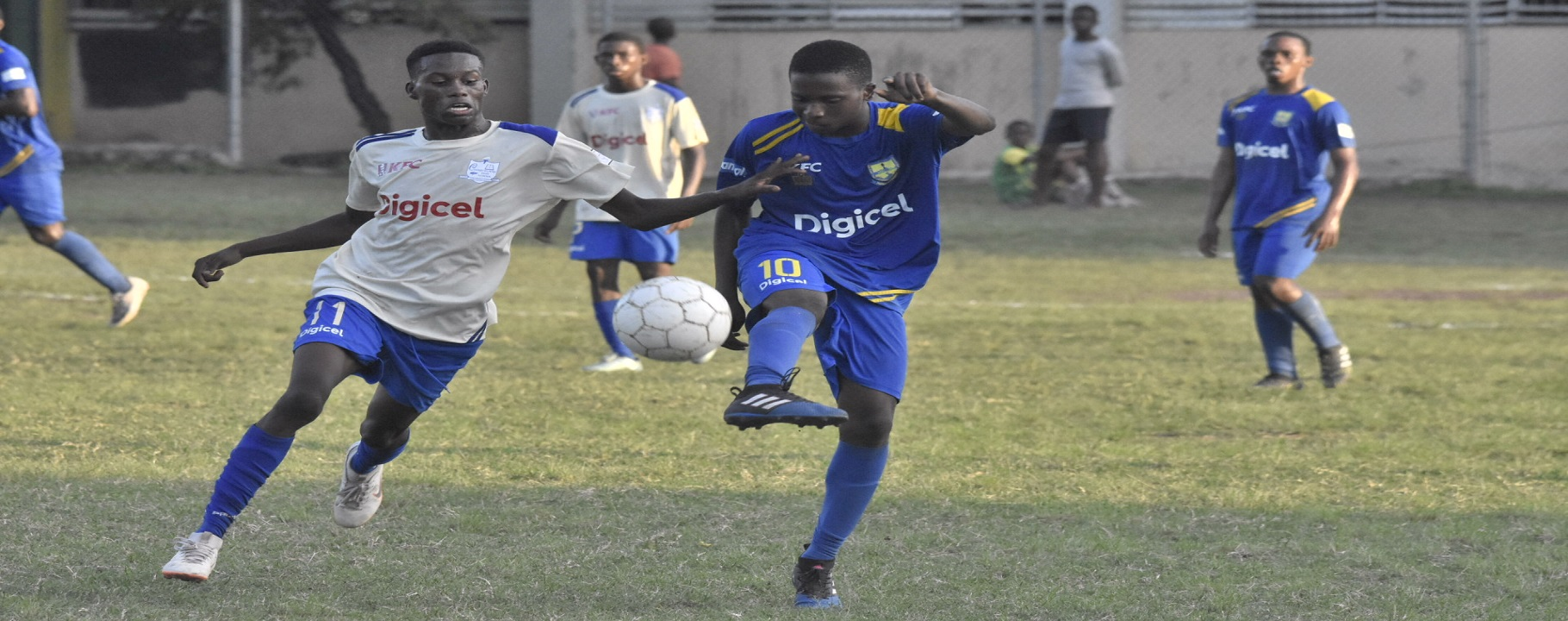 Bobby McLean (left) of Cumberland High and Papine High's goalscorer Rushike Nelson fight for possession during their Group A return leg fixture at Papine High on Saturday, October 13, 2018. Cumberland won 2-1. (PHOTOS: Marlon Reid).