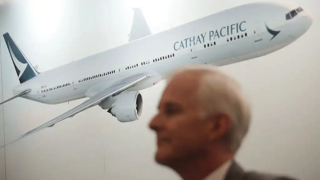 In this Aug. 16, 2017, file photo, Cathay Pacific Chairman John Slosar attends a news conference as he announces the company result in Hong Kong, Wednesday, Aug. 16, 2017. (AP Photo/Vincent Yu, File)