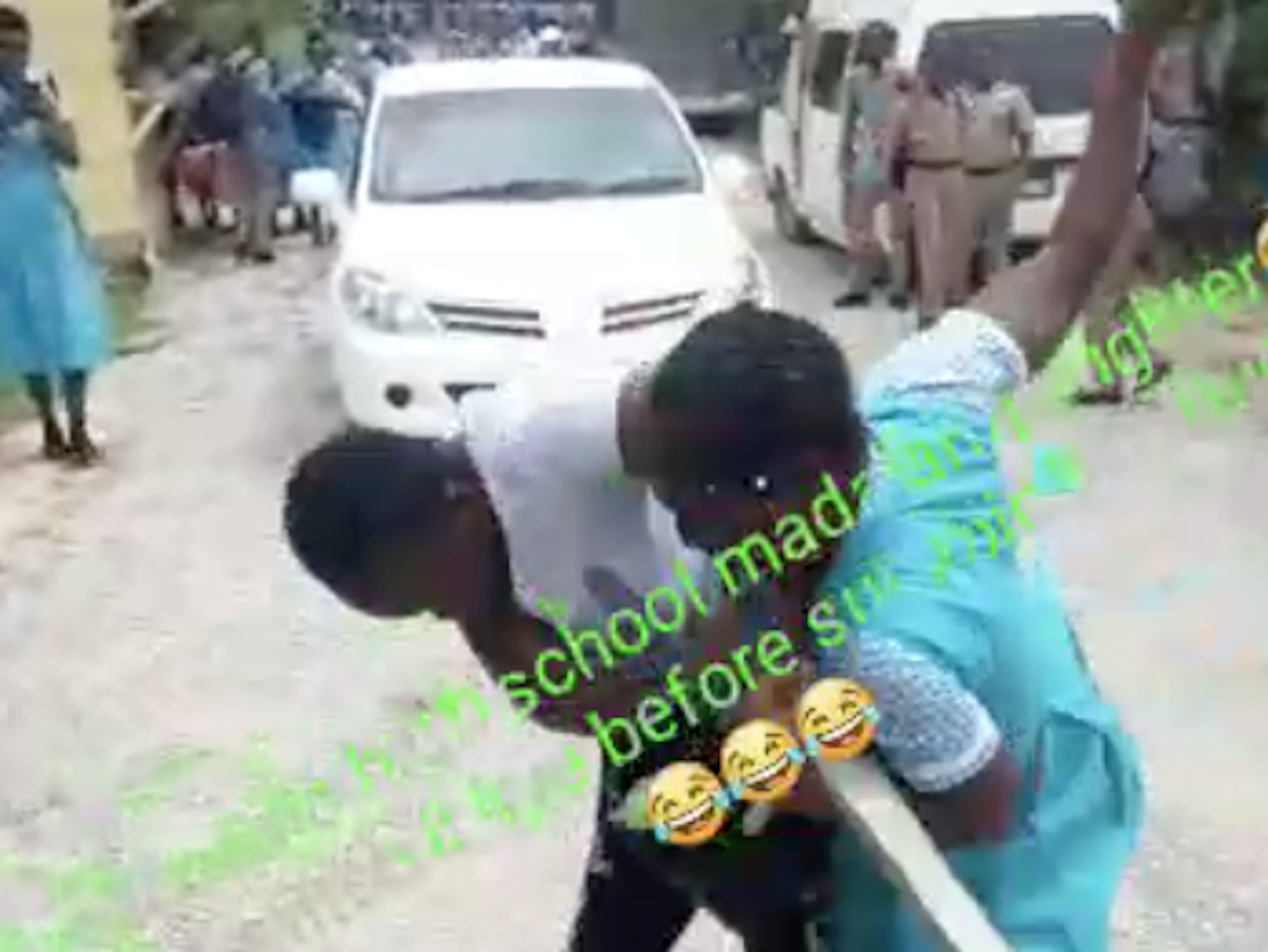 Screenshot of a viral video showing a child fighting her mother outside the Lacovia High School in St Elizabeth.