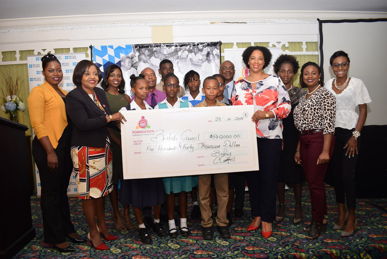 Pauleen Reid (second left), Director of Victoria Mutual Foundation, and Olayinka Jacobs-Bonnick (fourth right), Country Director at the British Council presented students and teachers from the six pilot schools with the seed funding to kick start their social enterprises.