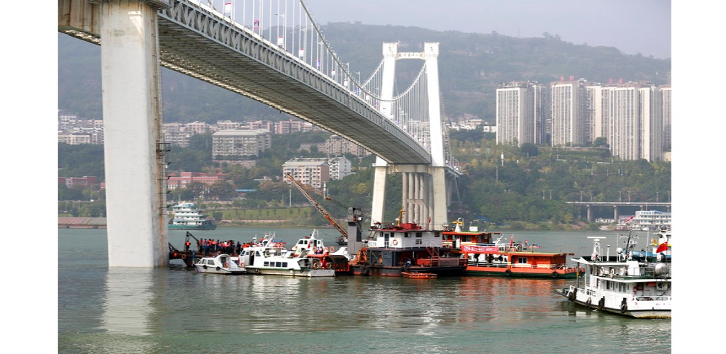 Rescuers conduct search and rescue operation at the site where a bus has plunged off a bridge into the Yangtze River in Wanzhou in southwest China's Chongqing Municipality Sunday, Oct. 28, 2018.