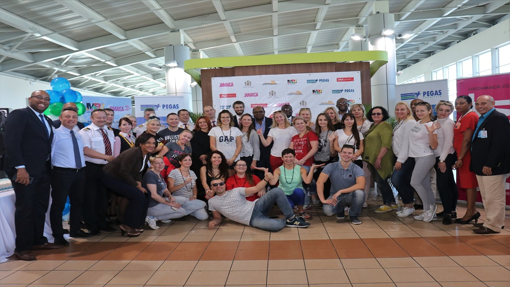 Travel agents, crew members of Nordwind Airlines and the local tourism delegation pose at the Sangster International Airport on Friday after the arrival of the flight with Russian tourists.