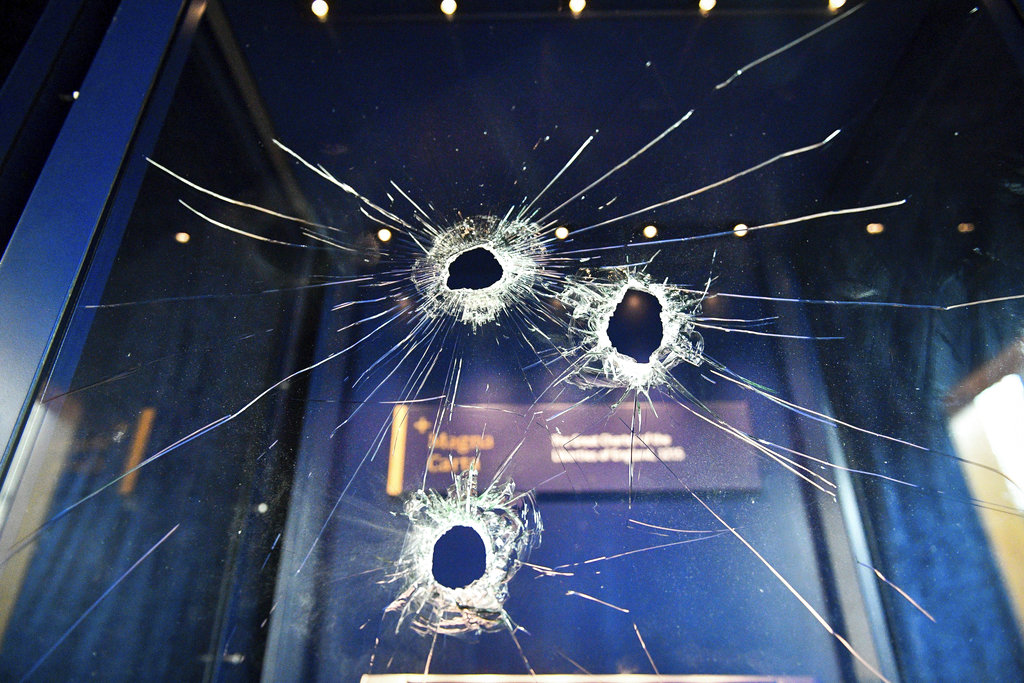 Hammer holes in the glass case that housed the Magna Carta, at Salisbury Cathedral after a 45-year-old man has been arrested on suspicion of its attempted theft, in Salisbury, England, Friday Oct. 26, 2018. (Ben Birchall/PA via AP)