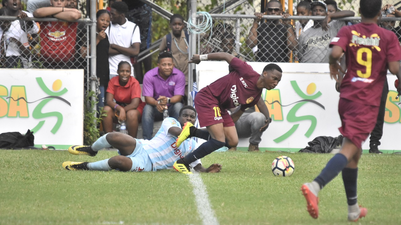 Last year's beaten finalists, St Andrew Technical High School (STATHS) and St George's College in Manning Cup action recently. (PHOTO: Marlon Reid).