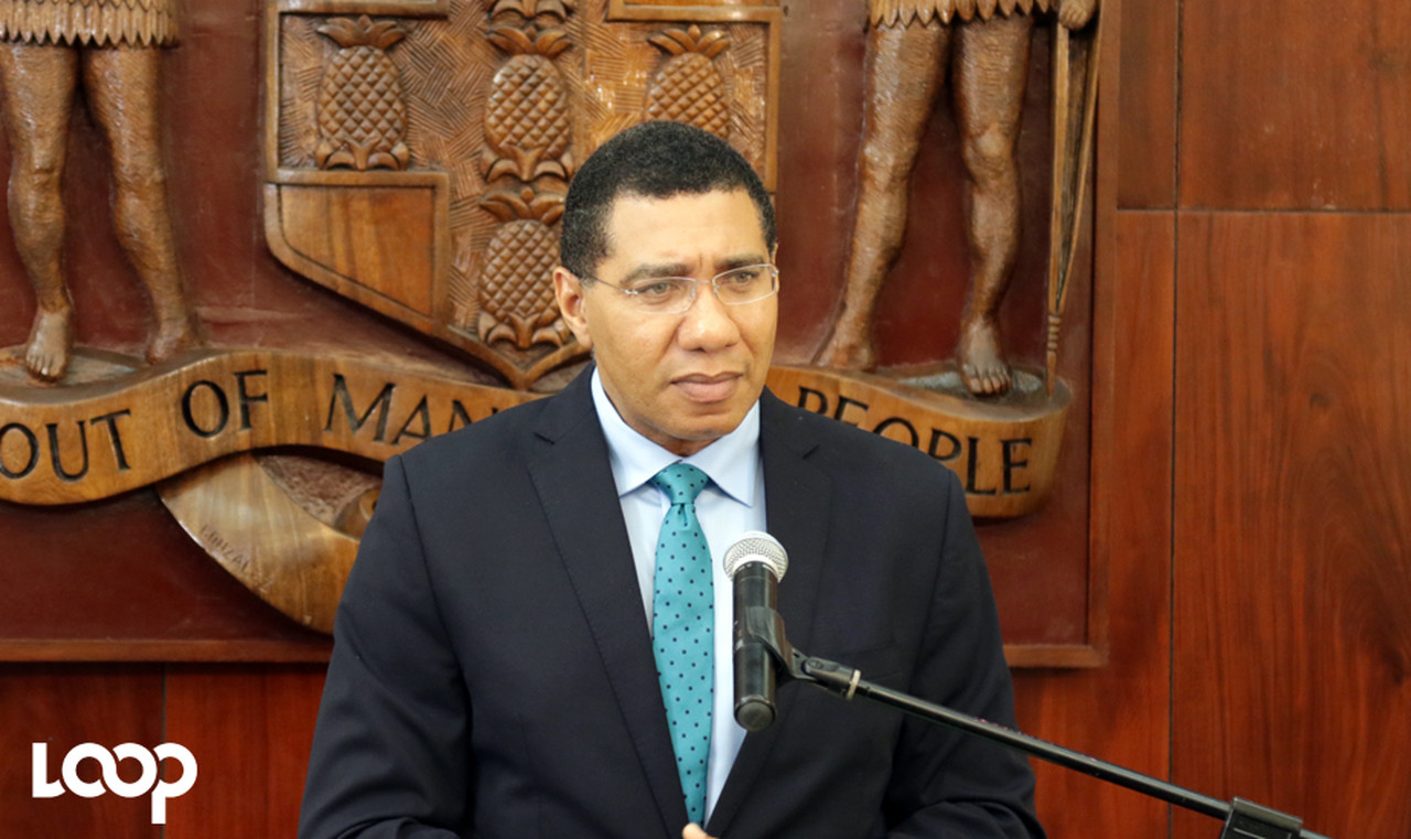 Prime Minister Andrew Holness addresses audience members at the handing over of solar panels at the Office of the Prime Minister.