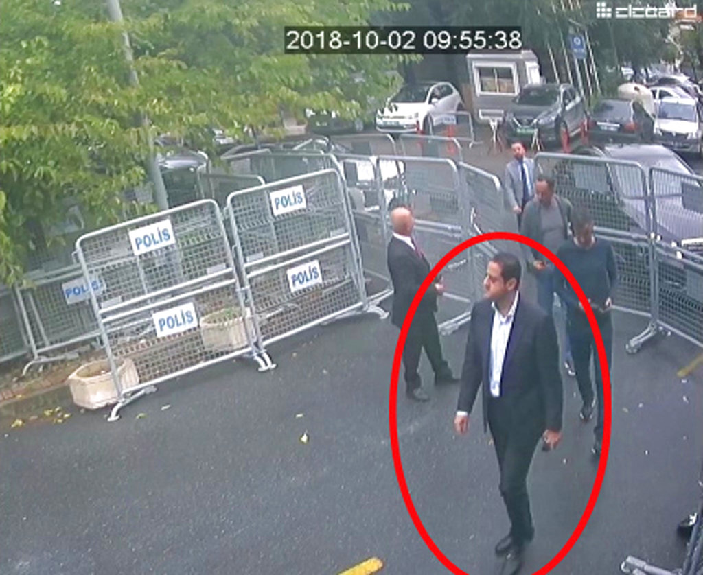 A man previously seen with Saudi Crown Prince Mohammed bin Salman's entourage during an April trip to the U.S. walks toward the Saudi Consulate in Istanbul just before writer Jamal Khashoggi disappeared there. (Sabah via AP )