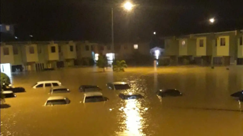 Cars submerged by flood water in Greenvale Park, La Horquetta