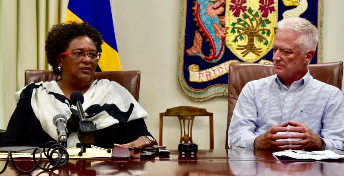 Prime Minister Mia Amor Mottley speaking at a press conference. Looking on is Managing Director of Crane Resorts, Paul Doyle. (GP)