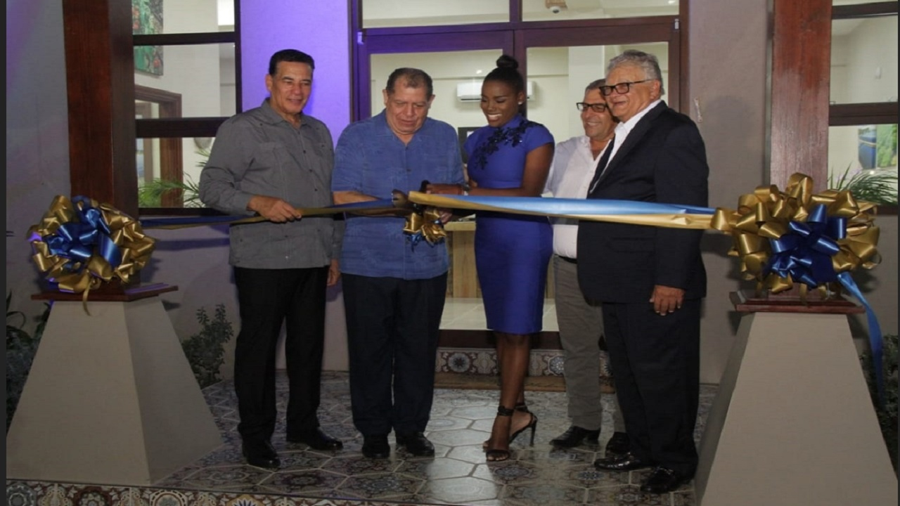 Photo caption: From left, Montego Bay Mayor, Homer Davis; Minister of Industry, Commerce, Agriculture and Fisheries, Audley Shaw; Miss Jamaica World Cornwall, Isiaa Thelwell; Chief Executive Officer, Isratech Jamaica Limited, Shalom Hodara; and Minister Without Portfolio in the Ministry of Economic Growth and Job Creation, Karl Samuda, share in the ribbon-cutting ceremony officially opening the Isratech complex in Reading, Montego Bay, St James on Wednesday.