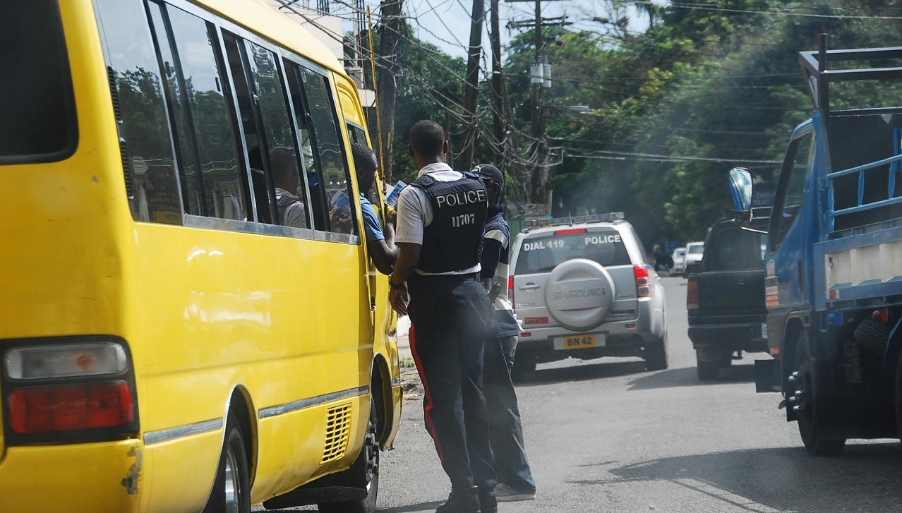 File photo of police officers conducting a spot check with a bus driver.
