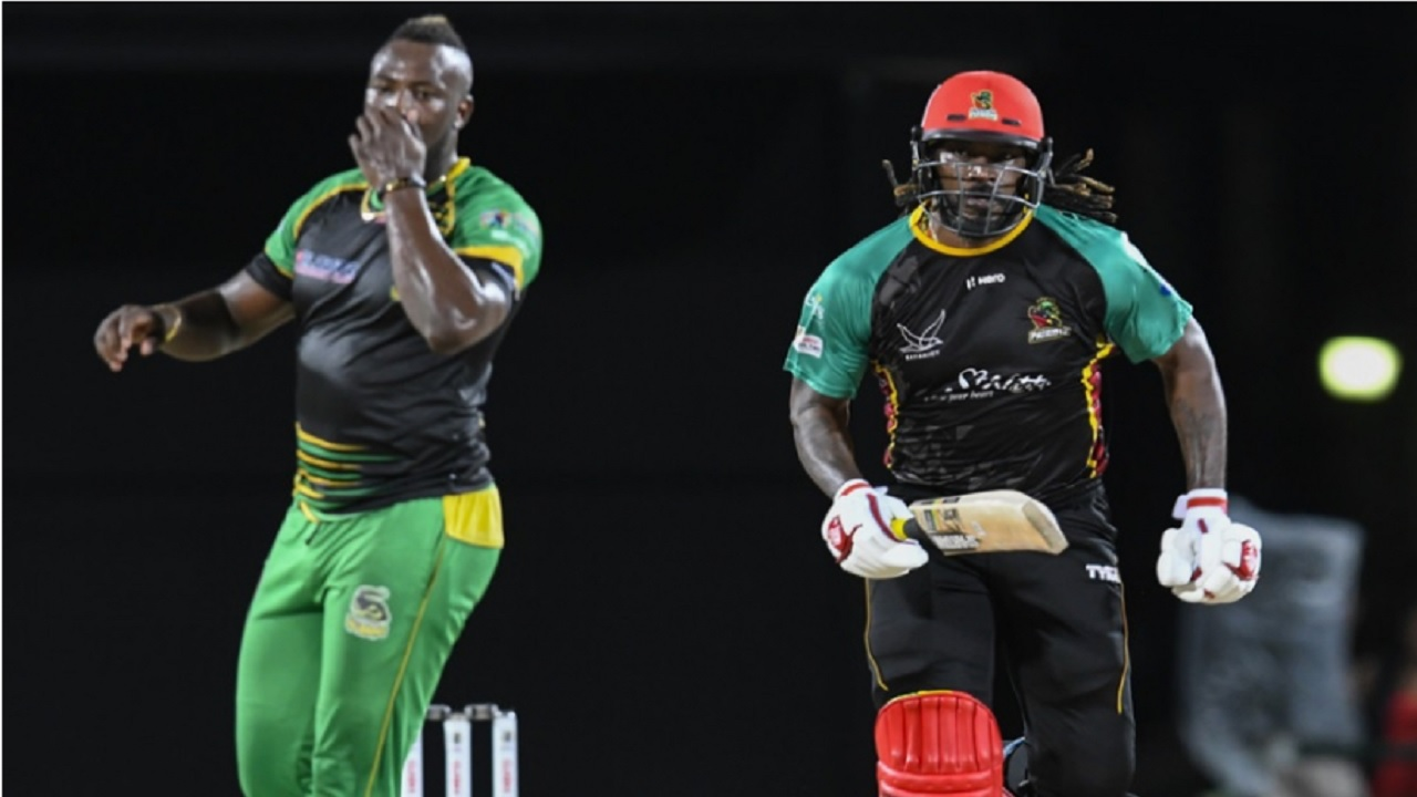 Andre Russell (left) and Chris Gayle during the 2018 Caribbean Premier League.