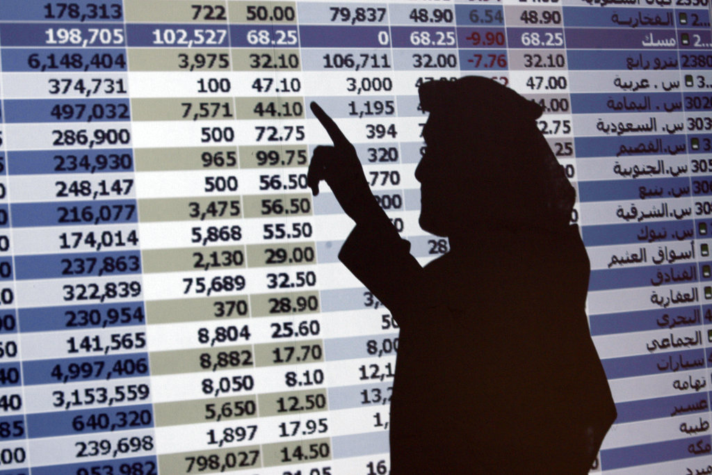 The shadow of a Saudi trader is seen on a stock market monitor in Riyadh, Saudi Arabia.  (AP Photo/Hassan Ammar, File)