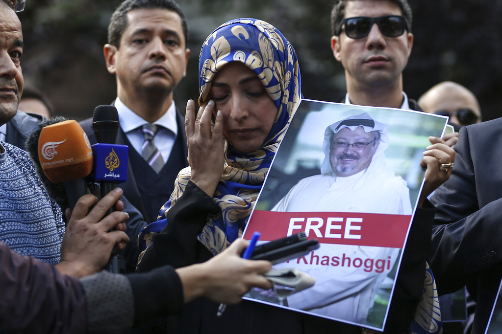 Holding a picture of missing Saudi writer Jamal Khashoggi, Tawakkol Karman, of Yemen the Nobel Peace Prize laureate for 2011, talks to members of the media near the Saudi Arabia consulate in Istanbul. (AP Photo/Emrah Gurel)