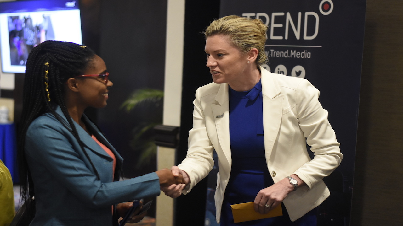 Trend Media CEO Aileen Corrigan (right) greets Michka McCreath, public relations manager at the Ministry of Labour at the company's breakfast meeting held at the Jamaica Pegasus hotel. (PHOTOS: Marlon Reid)