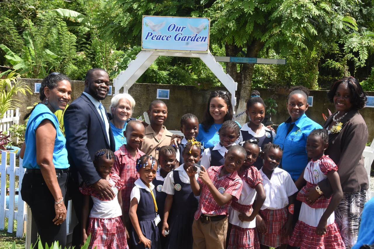 Nesline Lawrence (right), principal of Prospect Primary and her students take a group photo before their Peace Garden. Sharing in the moment are: (from left) Colleen Wint-Bond, project coordinator at the VPA; Lanceford Grant, education officer at  the Ministry of Education; Dr. Elizabeth Ward, chair of the VPA Cassidy Edwards, research assistant at the VPA and Lois Morgan at the Forestry Department.