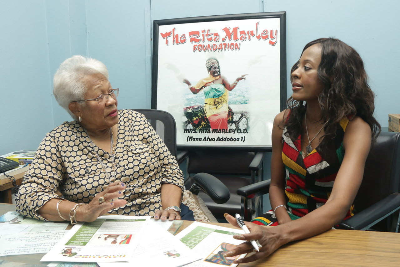 RosemaryDuncan, manager at theRita Marley Foundation(JA), discussing plans for the Public Speaking Competition with Merlene Heholt, Managing Director, Jamaica Fire Equipment Ltd.