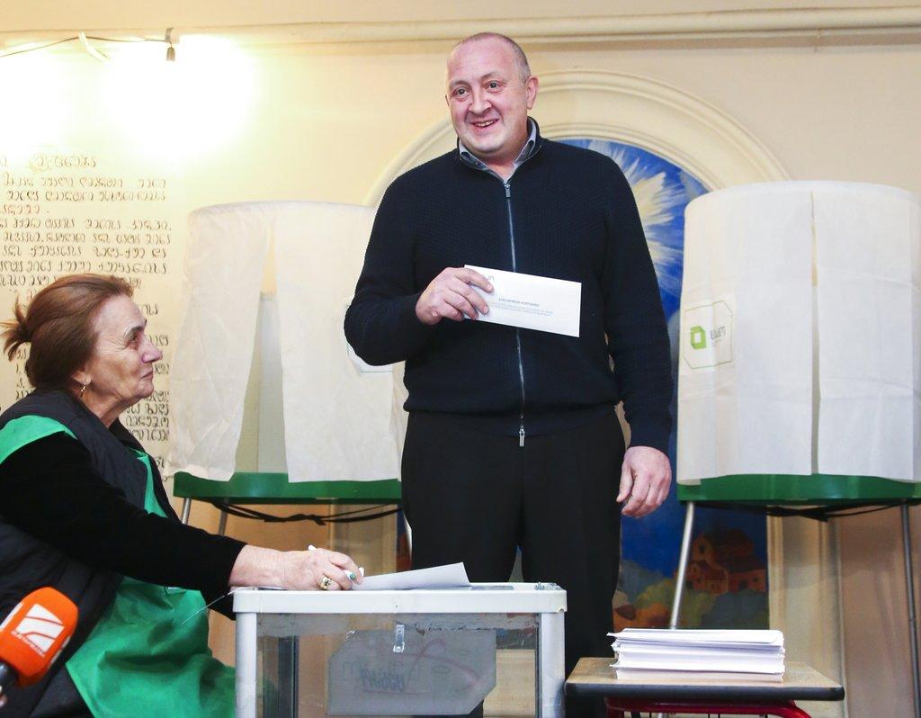 Georgian President Giorgi Margvelashvili prepares to cast his ballot at a polling station during presidential election in Tbilisi, Georgia. (Leli Blagonravova, Presidential Press Service Pool Photo via AP)