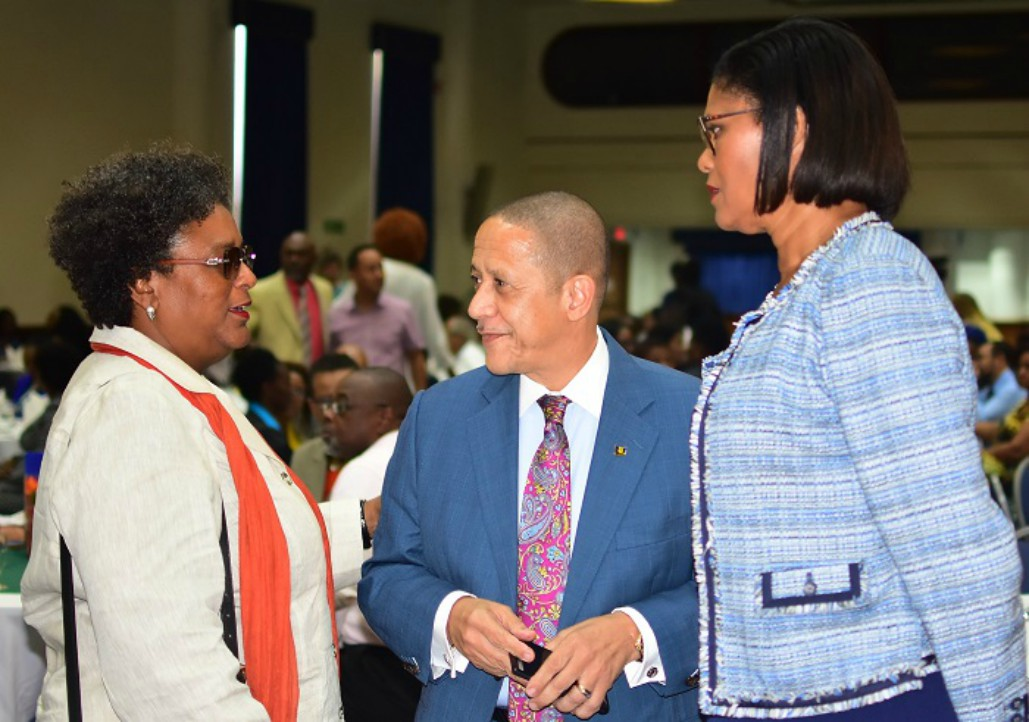 Prime Minister Mia Amor Mottley chatting with CEO of the Barbados Tourism Marketing Inc., William Griffith and Executive Vice President, Human Resources, Sagicor Life Inc., Marguerite Estwick, at yesterday's Barbados Hotel and Tourism Association's Annual General Meeting at the Lloyd Erskine Sandiford Centre. (C.Pitt/BGIS)