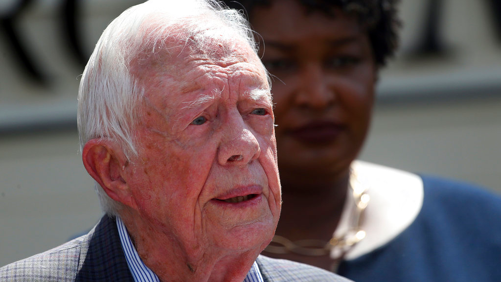 FILE - In this Sept. 18, 2018, file photo, former President Jimmy Carter speaks as Democratic gubernatorial candidate Stacey Abrams listens on during a news conference to announce her rural health care plan in Plains, Ga. (AP Photo/John Bazemore, File)
