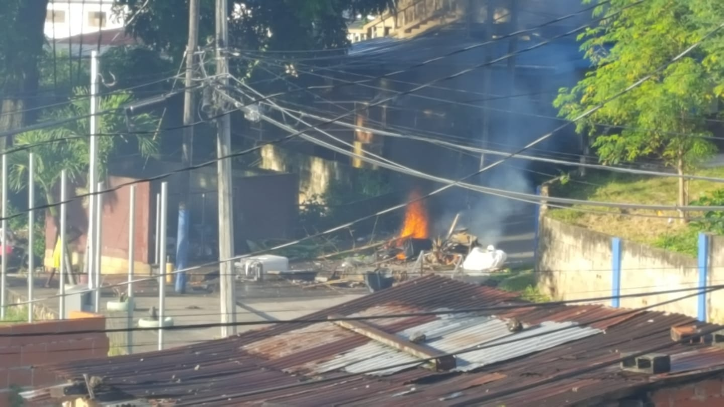 Residents stage fiery protests following the police involved shooting of five people, including two teenagers in Trou Macaque, Laventille last night. Photo via Facebook, Rodney Gonzalez.