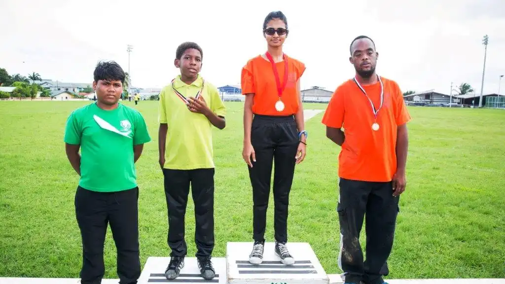 Athletes stand proud with their well-deserved medals after participating in the annual Special Olympics National Cricket Games which took place at the Constantine Park in Macoya