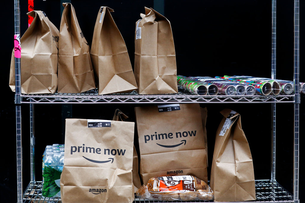 In this file photo, Prime Now customer orders are ready for delivery at the Amazon.