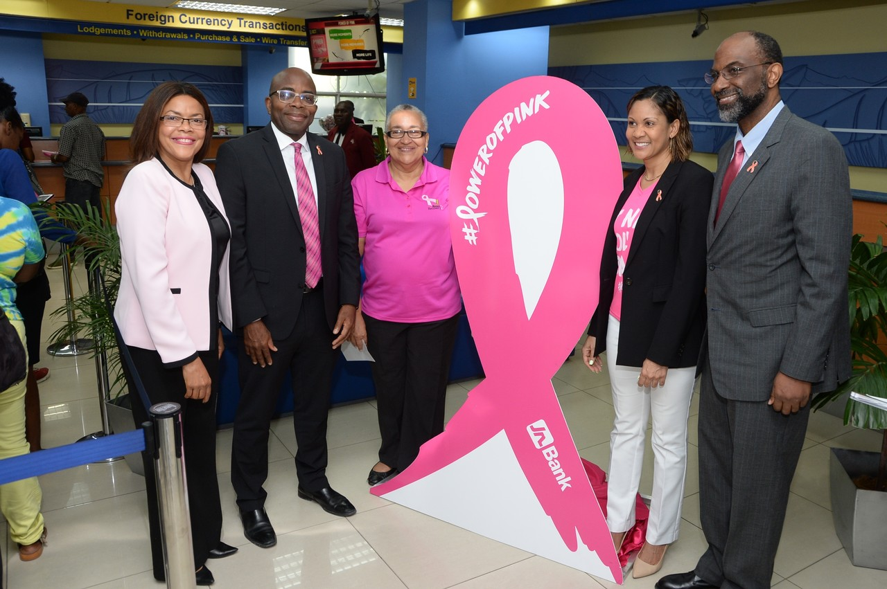 Earl Jarrett (right), Chief Executive Officer of the Jamaica National Group, is pictured with from left: Yulit Gordon, Executive Director, Jamaica Cancer Society; Curtis Martin, Managing Director, JN Bank; Carolind Graham, Chairperson, Jamaica Reach to Recovery; and Leesa Kow, Deputy Managing Director, JN Bank, during the launch of the JN Bank Power of Pink campaign.