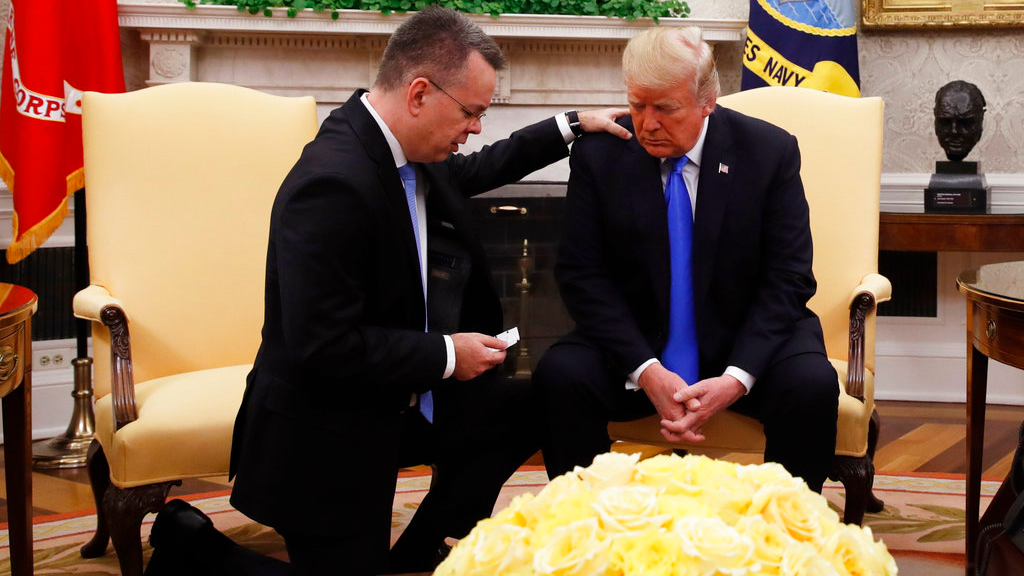 President Donald Trump prays with American pastor Andrew Brunson in the Oval Office of the White House. (AP Photo/Jacquelyn Martin)